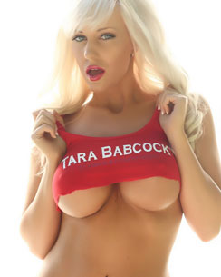 Fitness babe Tara Babcock from Alluring Vixens shows off her huge juicy tits in a skimpy tanktop that shows great under boob